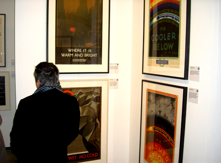 The exhibition space in which the posters are displayed are reminiscent of tightly packed stations and train carriages